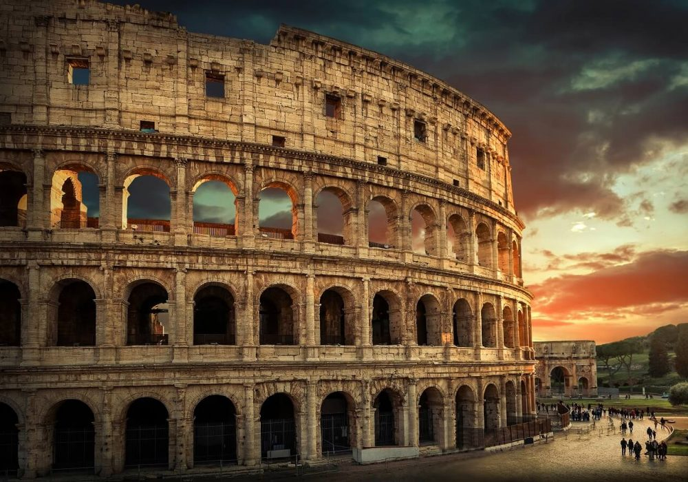 One of the most popular travel place in world – Roman Coliseum under evening sun light and sunrise sky.
